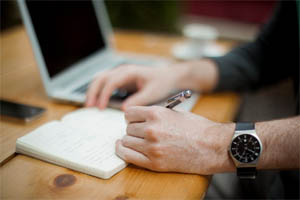 Man writing on desk